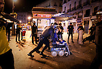 Police officers move a demonstrator as he and others are evicted during the early hours from Puerta del Sol square in Madrid, on May 13, 2012. The police moved in on the Puerta del Sol square in the early hours and within minutes removed the several hundred activists who had defied an official warning to disperse after 10:00 pm (2200 GMT) on Saturday. (c) Pedro ARMESTRE.