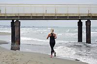 - Lido di Camaiore (Toscana), giovane donna corre sulla spiaggia<br /> <br /> - Lido di Camaiore (Tuscany), young woman runs on the beach