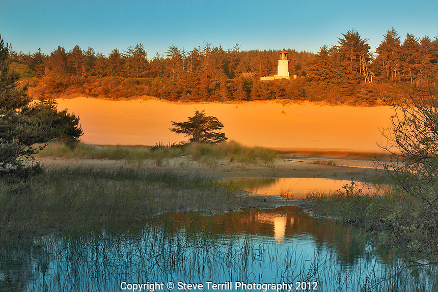 Umpqua River Lighthouse at sunset near Winchester Bay, Oregon