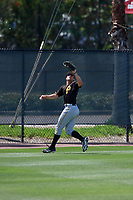 Pittsburgh Pirates center fielder Casey Hughston (92) tracks a fly ball during a minor league Spring Training game against the Philadelphia Phillies on March 24, 2017 at Carpenter Complex in Clearwater, Florida.  (Mike Janes/Four Seam Images)