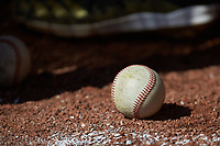 A baseball sits on the ground in the dugout of the Bryant Bulldogs during the game against the High Point Panthers at Williard Stadium on February 21, 2021 in  Winston-Salem, North Carolina. The Panthers defeated the Bulldogs 3-2. (Brian Westerholt/Four Seam Images)