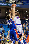 Houston Baptist Huskies forward Cody Joyce (42) and Texas-Arlington Mavericks forward Kevin Butler (24) in action during the game between the Houston Baptist Huskies and the Texas-Arlington Mavericks at the College Park Center arena in Arlington, Texas. UTA defeats Houston Baptist 81 to 47...