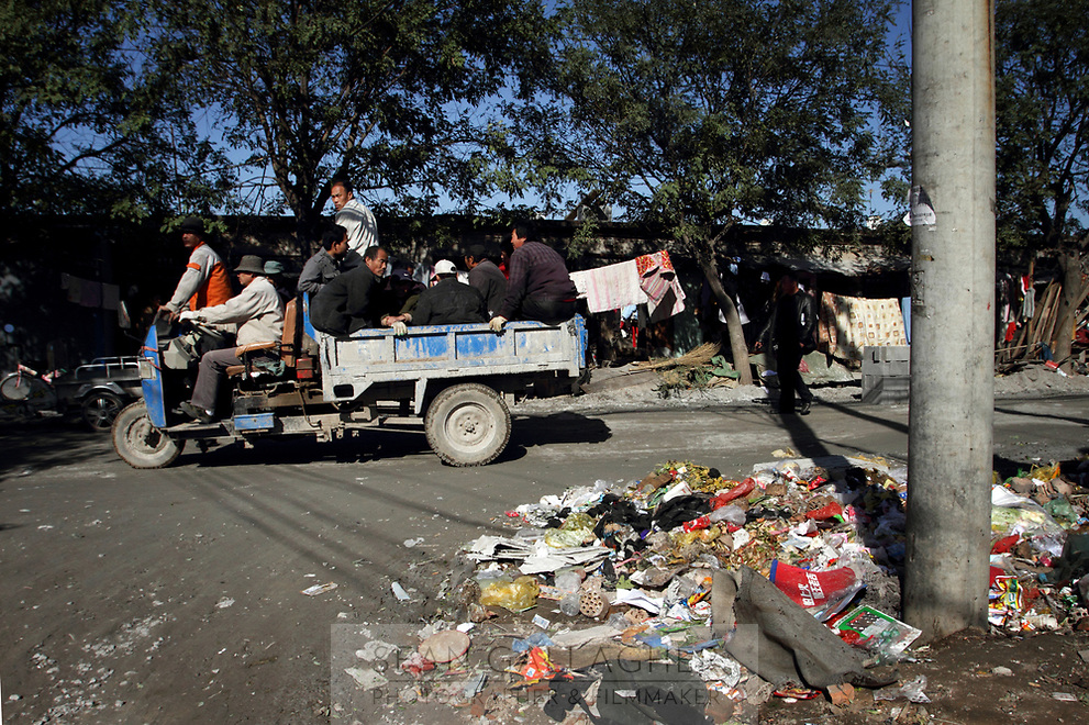 Trash discarded on the road in a migrant worker village on the outskirts of Beijing.
