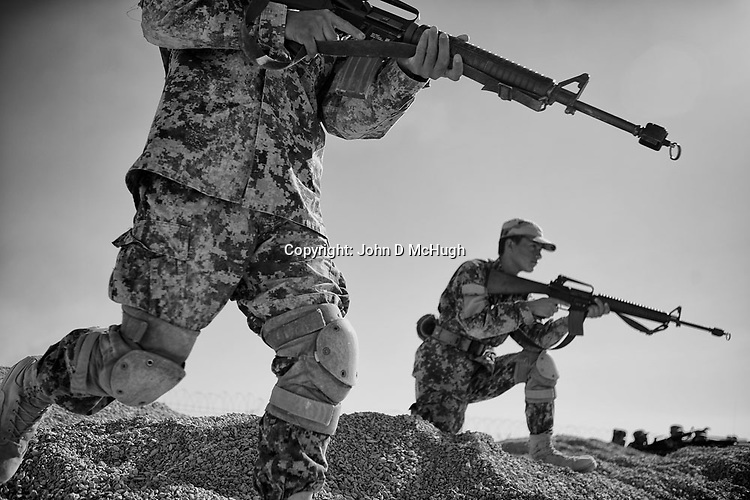 Afghan National Army soldiers practice ambush techniques at the Regional Training Centre in Helmand, 20 Nov 2012. (John D McHugh)