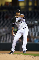 Charlotte Knights relief pitcher Juan Minaya (31) in action against the Toledo Mud Hens at BB&T BallPark on April 24, 2019 in Charlotte, North Carolina. The Knights defeated the Mud Hens 9-6. (Brian Westerholt/Four Seam Images)