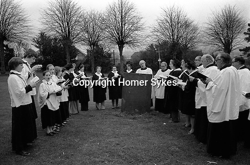 William Hubbard. 1976 Easter Saturday The Rev Crow and choir in the church yard of St Mary in Arden, Market Harborough Leicestershire.
