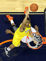 CHARLOTTESVILLE, VA- NOVEMBER 29: Trey Burke #3 of the Michigan Wolverines shoots the ball during the game on November 29, 2011 at the John Paul Jones Arena in Charlottesville, Virginia. Virginia defeated Michigan 70-58. (Photo by Andrew Shurtleff/Getty Images) *** Local Caption *** Trey Burke