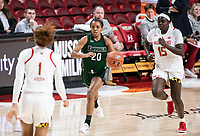 COLLEGE PARK, MD - DECEMBER 8: Ashley Owusu #15 of Maryland chases after Alexis Gray #20 of Loyola during a game between Loyola University and University of Maryland at Xfinity Center on December 8, 2019 in College Park, Maryland.
