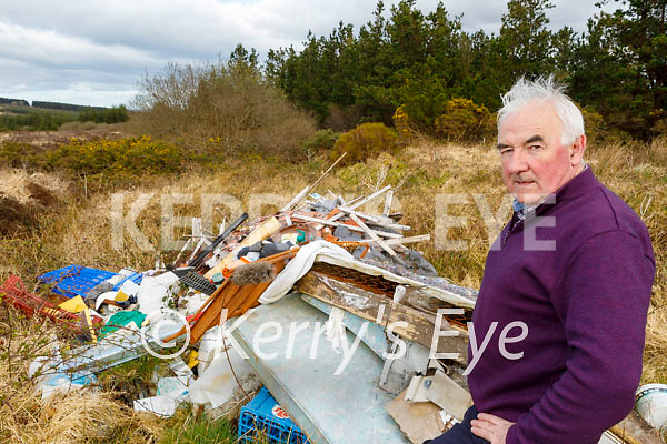 Cllr: Charlie Farrelly standing at the site of the illegal dumping that happened since Easter weekend, in Ahaneboy, Castleisland on Tuesday.
