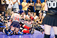 The Brooklyn Bombshells celebrate a victory over the Queens of Pain at a Gotham Girls Roller Derby bout in New York City on June 2, 2006.