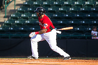 Rock Shoulders (17) of the Hickory Crawdads follows through on his swing against the Savannah Sand Gnats at L.P. Frans Stadium on June 14, 2015 in Hickory, North Carolina.  The Crawdads defeated the Sand Gnats 8-1.  (Brian Westerholt/Four Seam Images)