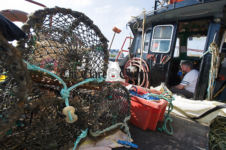 Gerry O Connell of Doolin takes a break while preparing his and his brother Michael's half decker boat for the first lobster fishing trip of the season out of Liscannor harbour. Photograph by John Kelly.