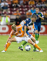 Houston Dynamo midfielder Stuart Holden (22) and Seattle Sounders midfielder Osvaldo Alonso (6) fight for the ball.  Houston Dynamo tied Seattle Sounders 1-1 on August 23, 2009 at Robertson Stadium in Houston, TX.