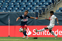 FOXBOROUGH, MA - JULY 23: Pierre Cayet #44 of New England Revolution II passes the ball as Steffen Yeates #72 of Toronto FC II defends during a game between Toronto FC II and New England Revolution II at Gillette Stadium on July 23, 2021 in Foxborough, Massachusetts.
