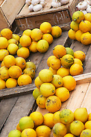 A market stall street market merchant selling in piles with 10 ten lemons. Montevideo, Uruguay, South America