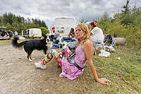Pictured: A young woman rests on the ground. Monday 31 August 2020<br /> Re: Around 70 South Wales Police officers executed a dispersal order at the site of an illegal rave party, where they confiscated sound gear used by the organisers in woods near the village of Banwen, in south Wales, UK.