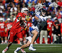 Will McKee (50) of Duke is tangled up with Bryn Holmes (17) of Maryland during the Face-Off Classic in at M&T Stadium in Baltimore, MD
