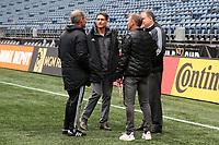 SEATTLE, WA - NOVEMBER 9: Seattle Sounders FC owner Adrian Hanauer talks with head coach Brian Schmetzer, general manger Garth Lagerwey, and technical directory Chris Henderson at CenturyLink Field on November 9, 2019 in Seattle, Washington.