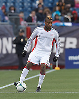 New England Revolution defender Andrew Farrell (2) brings the ball forward.   In a Major League Soccer (MLS) match, Sporting Kansas City (blue) tied the New England Revolution (white), 0-0, at Gillette Stadium on March 23, 2013.