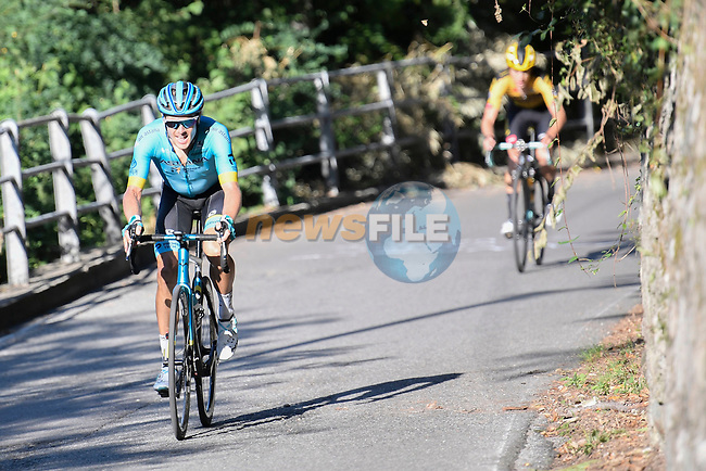 Jakob Fuglsang (DEN) Astana Pro Team attacks George Bennett (NZL) Team Jumbo-Visma as they climb the Civiglio during the 114th edition of Il Lombardia 2020, running 231km from Bergamo to Como, Italy. 15th August 2020.<br /> Picture: LaPresse/Fabio Ferrari | Cyclefile<br /> <br /> All photos usage must carry mandatory copyright credit (© Cyclefile | LaPresse/Fabio Ferrari)