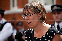 Rebecca O'Brien (Independent film producer) reads Ken Loach message.<br /> <br /> London, 19/08/2012. Today, Julian Assange made his first speech after two months (19th June 2012) he has been living as a refugee in the Ecuadorian Embassy in London. On Thursday he was granted Diplomatic Asylum by the President of Ecuador, Rafael Correa. Previously, Baltasar Garzón (former Spanish Judge, now head of Assange legal team), Tariq Ali, Craig Murrey and others had made speeches in support and solidarity with the Australian Journalist founder of Wikileaks.