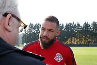 TUKWILA, WA - NOVEMBER 08: Nick DeLeon #18 of Toronto FC talks with a reporter at Starfire Sports Complex on November 08, 2019 in Tukwila, Washington.