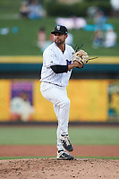 Winston-Salem Dash relief pitcher Ty Madrigal (20) in action against the Greensboro Grasshoppers at Truist Stadium on August 13, 2021 in Winston-Salem, North Carolina. (Brian Westerholt/Four Seam Images)