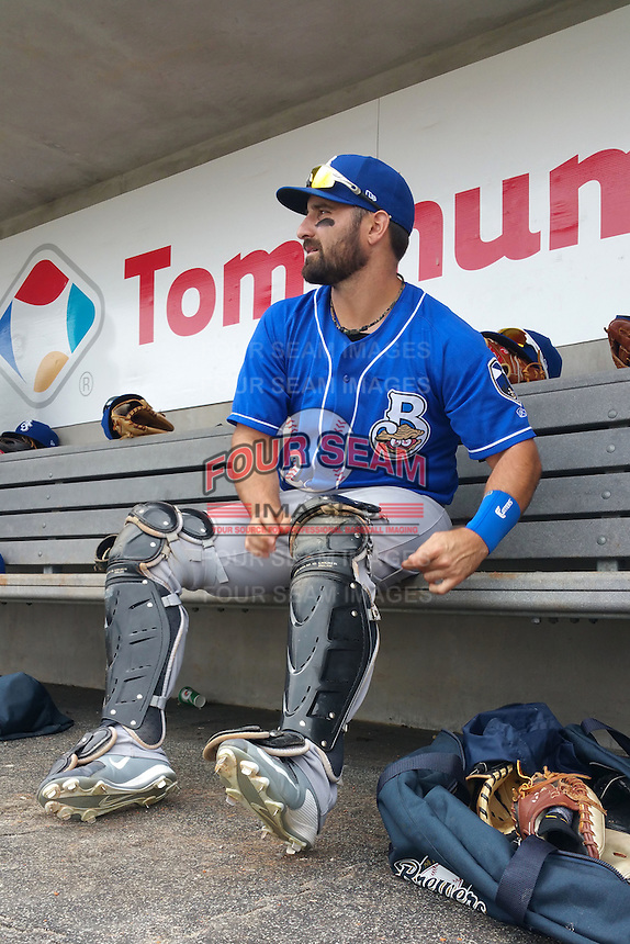 Biloxi Shuckers catcher Tyler LaTorre (22) puts his catchers gear on in the dugout during the first game of a double header against the Pensacola Blue Wahoos on April 26, 2015 at Pensacola Bayfront Stadium in Pensacola, Florida.  Biloxi defeated Pensacola 2-1.  (Mike Janes/Four Seam Images)