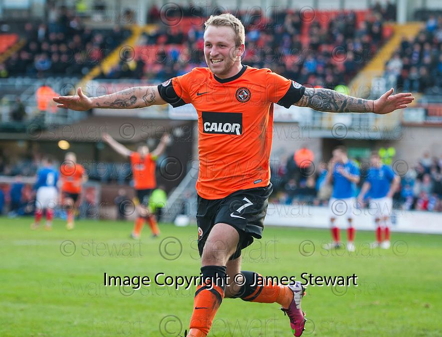 United's Johnny Russell celebrates after he scores united's third.