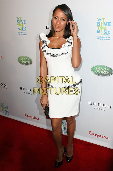 """DANIA RAMIREZ .VH1 Save the Music Foundation partners with Esquire Magazine's """"Hollywood Hills"""" House host a benefit to celebrate music education in LA public schools held at Esquire House in the Hollywood Hills, Hollywood, California, USA, 25th October 2008..full length white ruffle neck dress black trim shoes clutch bag ruffles .CAP/ADM/TC.©T. Conrad//Admedia/Capital Pictures"""