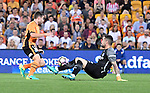 BRISBANE, AUSTRALIA - OCTOBER 30: Tommy Oar of the Roar dribbles the ball around Melbourne City goalkeeper Dean Bouzanis during the round 5 Hyundai A-League match between the Brisbane Roar and Melbourne City at Suncorp Stadium on November 4, 2016 in Brisbane, Australia. (Photo by Patrick Kearney/Brisbane Roar)