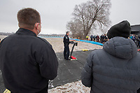 Fayetteville Fire Chief Brad Hardin (left) and mayor Lioneld Jordan watch as police chief Mike Reynolds speaks Thursday Feb. 11, 2021 during a ground breaking ceremony for a new police headquarters and fire substation near Porter Road and Deane Street. Voters in 2019 approved a nearly $37 million bond issue to build a new headquarters for the city's Police Department, as well as a fire substation. The headquarters will include a new main station to replace the station on Rock Street, an indoor firing range and more space for vehicle and evidence storage. Visit nwaonline.com/210111Daily/ and nwadg.com/photos. (NWA Democrat-Gazette/J.T. Wampler)