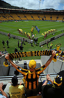 The teams walk onto the pitch before the A-League football match between Wellington Phoenix v Sydney FC at Westpac Stadium, Wellington, New Zealand on Wednesday, 4 January 2012. Photo: Dave Lintott / lintottphoto.co.nz
