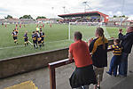 Stenhousemuir 0 Alloa Athletic 1, 21/08/2010. Stadium, Scottish Second Division. Supporters of Alloa Athletic football club (in yellow) celebrating their team's goal at Ochilview stadium, Larbert, during their Irn Bru Scottish League second division match against Stenhousemuir. Alloa won the match by one goal to nil against their local rivals in a match watched by 619 spectators. The goal was scored by Alloa's number 9 Brian Prunty. Photo by Colin McPherson.