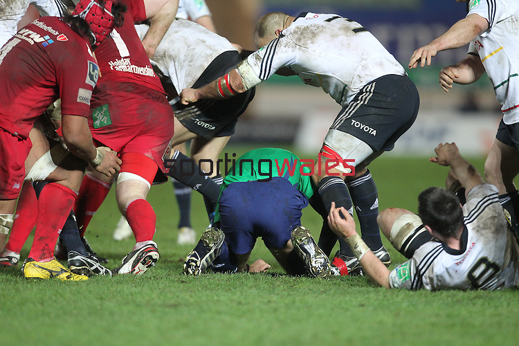 Referee Romain Poite gets caught up in the action..Heineken Cup.Scarlets v Munster.Parc y Scarlets.10.12.11.©Steve Pope