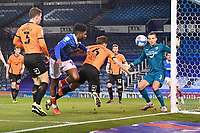Alex Gorrin of Oxford United heads the ball away from Ellis Harrison of Portsmouth during Portsmouth vs Oxford United, Sky Bet EFL League 1 Football at Fratton Park on 24th November 2020