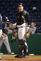 Catcher Tyson Blaser #24 of the Iowa Hawkeyes during the Big East-Big Ten Challenge vs. the Pittsburgh Panthers at Bright House Field in Clearwater, Florida;  February 19, 2011.  Photo By Mike Janes/Four Seam Images