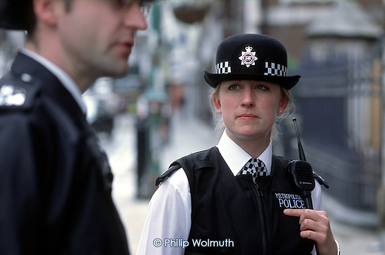 Officers from the Brick Lane police office on patrol in Whitechapel, London.