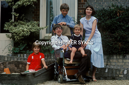 Professor Stephen Hawking 1981 Cambridge UK 1980s with young family. <br /> L-R Seen here with Lucy, eldest son Robert,(behind)   Tim on his knee, wife Jane.