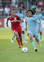 18 August 2012: Sporting KC midfielder Roger Espinoza #15 and Toronto FC midfielder Luis Silva #11 in action during an MLS game between Sporting Kansas City and Toronto FC at BMO Field in Toronto, Ontario Canada..Sporting Kansas City won 1-0.