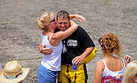 Jul. 18, 2009; Augusta, GA, USA; IHBA top fuel hydro driver Scotty Lumbert is hugged after crashing during qualifying for the Augusta Southern Nationals on the Savannah River. Mandatory Credit: Mark J. Rebilas-