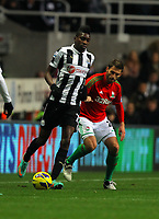 Saturday 17 November 2012<br /> Pictured: Angel Rangel of Swansea against Cheick Tiote<br /> Re: Barclay's Premier League, Newcastle United v Swansea City FC at St James' Park, Newcastle Upon Tyne, UK.