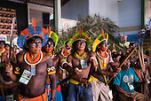 Altamira, Brazil. Encontro Xingu protest meeting about the proposed Belo Monte hydroeletric dam and other dams on the Xingu river and its tributaries. Kayapo from Gorotire village feeling the tension, ready to fight to the end to save the Xingu.