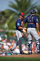 Minnesota Twins manager Paul Molitor (4) makes a pitching change as catcher John Hicks looks on during a Spring Training game against the Baltimore Orioles on March 7, 2016 at Ed Smith Stadium in Sarasota, Florida.  Minnesota defeated Baltimore 3-0.  (Mike Janes/Four Seam Images)