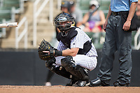 Kannapolis Intimidators catcher Casey Schroeder (17) looks to the dugout for a sign during the game against the West Virginia Power at Kannapolis Intimidators Stadium on June 18, 2017 in Kannapolis, North Carolina.  The Intimidators defeated the Power 5-3 to win the South Atlantic League Northern Division first half title.  It is the first trip to the playoffs for the Intimidators since 2009.  (Brian Westerholt/Four Seam Images)