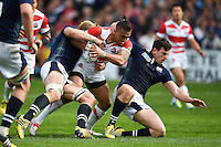 Male Sa'u of Japan takes on the Scotland defence. Rugby World Cup Pool B match between Scotland and Japan on September 23, 2015 at Kingsholm Stadium in Gloucester, England. Photo by: Patrick Khachfe / Stewart Communications