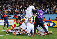 USA players pile on top of Landon Donovan after the game winning goal. USA defeated Algeria 1-0 in stoppage time in the 2010 FIFA World Cup at Loftus Versfeld Stadium in Pretoria, Sourth Africa, on June 23th, 2010.