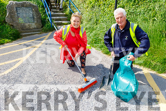 Noel Nash (Chairperson) and Kathleen Collins (Treasurer) of the Ballybunion Tidy Towns cleaning up at the foot of the steps leading to the Nuns Beach cliff walk on Sunday.
