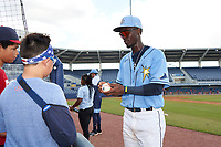 FCL Rays Alejandro Pie (64) signs autographs after a game against the FCL Twins on July 20, 2021 at Charlotte Sports Park in Port Charlotte, Florida.  (Mike Janes/Four Seam Images)