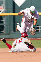 Miami Hurricanes second baseman George Iskenderian (7) jumps at second base during the NCAA College baseball World Series against the Arkansas Razorbacks  on June 15, 2015 at TD Ameritrade Park in Omaha, Nebraska. Miami beat Arkansas 4-3. (Andrew Woolley/Four Seam Images)